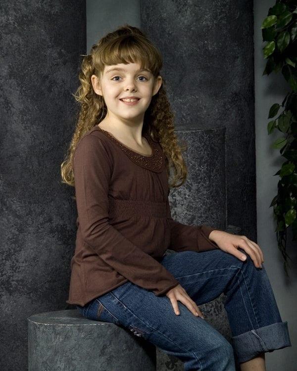 Professional Photo Child Sitting Down