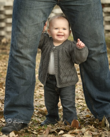 Professional Photo of Young Child Outside in Leaves