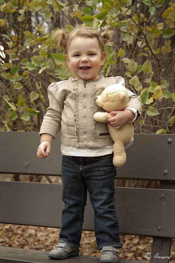Professional Photo Child Outside with Stuffed Bear