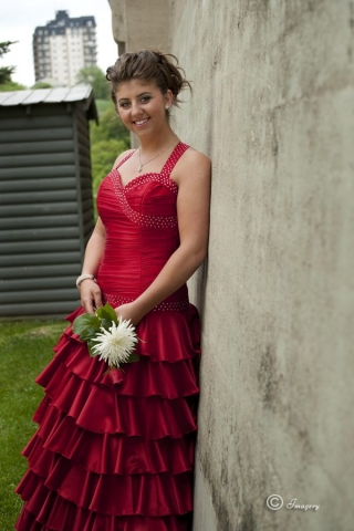 Professional Photo of Graduate in Red Dress