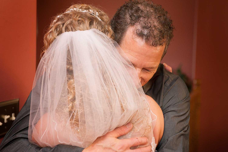 Professional Wedding Picture of Bride Hugging Man