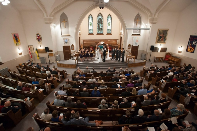 Professional Wedding Picture of Bridge and Groom in Church